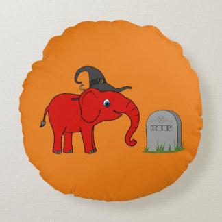 Elefante rojo con la piedra del sepulcro del cojín redondo