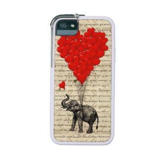 Elefante y globo rojo del corazón