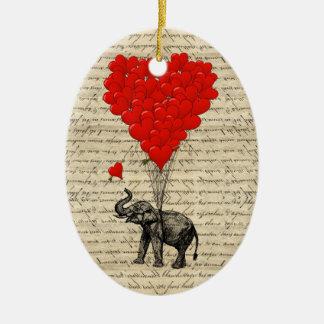 Elefante y globos en forma de corazón adorno ovalado de cerámica