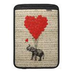 Elefante y globos en forma de corazón fundas MacBook