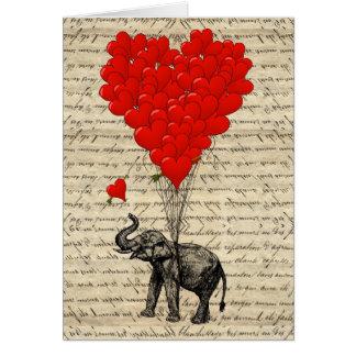 Elefante y globos en forma de corazón tarjeta