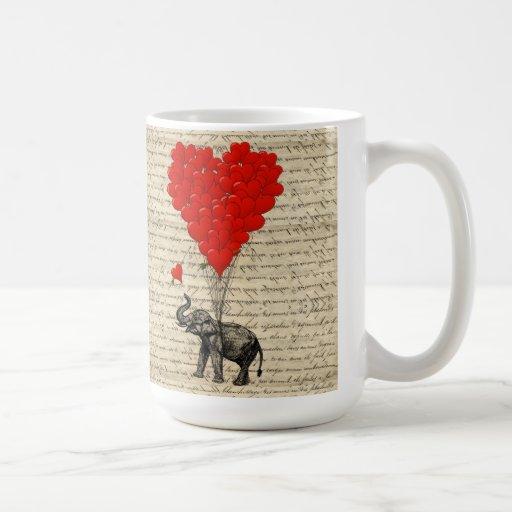 Elefante y globos en forma de corazón taza