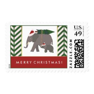 Elefantes del navidad con los gorras, el árbol, y sello postal