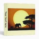 Elefantes en la carpeta de la puesta del sol