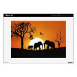 Elefantes en la puesta del sol portátil skin