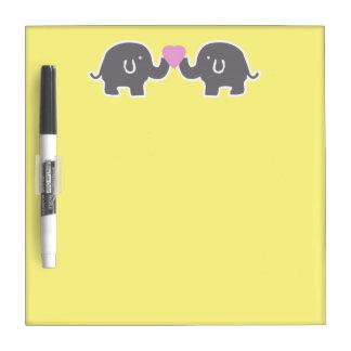 Elefantes lindos grises y amarillos con el corazón tableros blancos