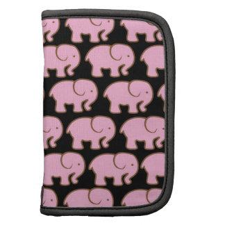 Elefantes lindos rosados bonitos en negro planificador