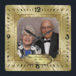 """Elegant 50th Wedding Anniversary Photo Wall Clock<br><div class=""""desc"""">A Digitalbcon Images Design featuring a gold color and flourish design theme with a variety of custom images, shapes, patterns, styles and fonts in this one-of-a-kind &quot;Elegant 50th Wedding Anniversary&quot; Photo Wall Clock. This elegant and attractive design comes complete with customizable text lettering to suit your own special occasion and...</div>"""