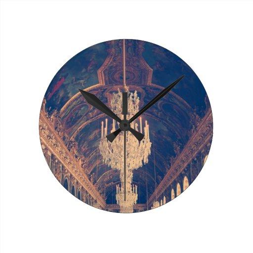 Elegant and vintage chandelier round clock