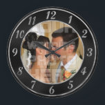 """Elegant Black and Silver Wedding Photo Clock<br><div class=""""desc"""">Stylish photo template wedding clock. Great to remember the time...  that you got married.   Template Image First Kiss by Alena Kratochvilova   http://www.publicdomainpictures.net/view-image.php?image=1128&amp;picture=first-kiss</div>"""