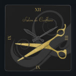 """Elegant Black Curls Faux Gold Scissors Hair Salon Square Wall Clock<br><div class=""""desc"""">Keep appointments on schedule with this black and gold hair salon wall clock with a pair of faux gold scissors entwined in a soft silhouette of beautiful curls. Keep or remove the roman numerals depending on your personal style. Personalize by adding the name of the hair salon or hairstylist. Flat...</div>"""