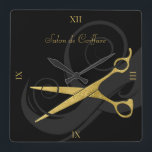 "Elegant Black Curls Faux Gold Scissors Hair Salon Square Wall Clock<br><div class=""desc"">Keep appointments on schedule with this black and gold hair salon wall clock with a pair of faux gold scissors entwined in a soft silhouette of beautiful curls. Keep or remove the roman numerals depending on your personal style. Personalize by adding the name of the hair salon or hairstylist. Flat...</div>"