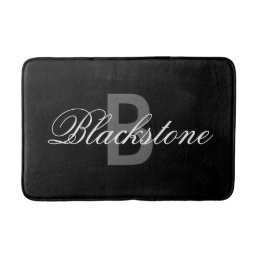 Elegant black monogram bath mat for bathroom