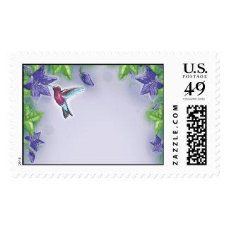 elegant colorful hummingbird and purple flowers postage stamp