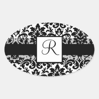 Elegant damask calligraphy design oval sticker