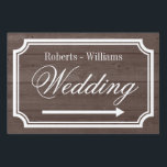 "Elegant double sided directional wedding yard sign<br><div class=""desc"">Elegant personalized wooden texture wedding yard sign pointing left or right. Turn arrow to your preference. Help guests find their way to your vintage reception party. Classy double sided design with stylish border plus last name of bride and groom. Fancy traditional style script typography. Available for left and right direction....</div>"