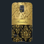 "Elegant Floral Damask Black and Gold Galaxy S5 Cover<br><div class=""desc"">Elegant Floral Damask Black Gold Pattern Print. Black and Gold . Elegant Classy Phone Mobile Case Girly for Women girl Add Name Initials Glitter (Be advised that image will appear darker on Case) Fabulous product for Women, Girls, Zizzago created this design PLEASE NOTE all flat images! They Do NOT have...</div>"