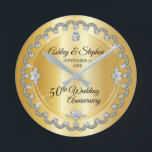 "Elegant Gold Diamonds 50th Wedding Anniversary Round Clock<br><div class=""desc"">Opulent elegance frames this wedding anniversary design in a unique scalloped diamond design with center teardrop diamond with faux added sparkles on a gold-tone gradient. Please note that all embellishments are printed and are only made to appear as real as possible in a flat, printed design. This includes any metallic...</div>"