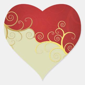 Elegant golden swirls on red and cream heart sticker