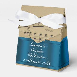 Elegant music sheet and blue wedding party favor box