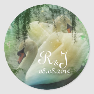 Elegant pair of white swans classic round sticker