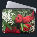 "Elegant Red Tulips Personalized Laptop Sleeve<br><div class=""desc"">A photographic image of an exquisite bouquet of red flowers,  tulips,  roses,  gerbera daisies and white baby&#39;s breath with dark green foliage creates a chic floral design,  personalized with her name on a convenient ladies laptop sleeve makes a unique gift.</div>"