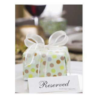 Elegant table setting with gift postcard