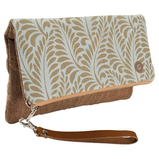 Elegant taupe botanical leaves with monogram clutch