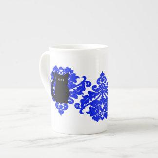 Elegant victorian damask black cat and royal blue tea cup
