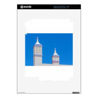 Elegant white chimneys in blue sky.JPG Skins For iPad 2
