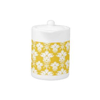 Elegant white damask pattern on dark yellow teapot