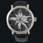 """Elegant White Edelweiss Watch<br><div class=""""desc"""">Pretty wrist watch with a photo of a single Alpine flower bloom of an Edelweiss,  on a black background.  White dots and numbers decorate around the outside edge of the face.  Customize to add any text you want.</div>"""