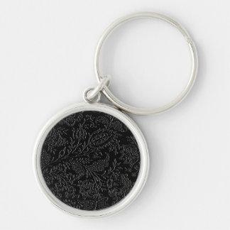 Elegant white floral pattern on a black background keychain