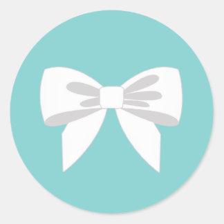Elegant White Ribbon on Teal Blue Classic Round Sticker