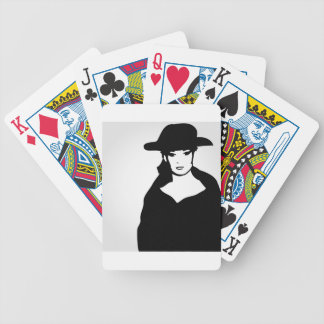 Elegant woman in a hat bicycle playing cards
