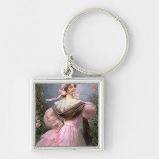 Elegant woman in a rose garden keychain