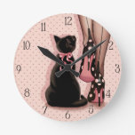 Elegant young woman and black cat round wall clock