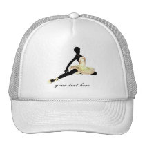 elegantly dressed ballerina in ivory trucker hat