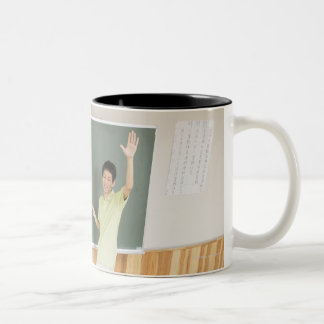 Elementary school students at school Two-Tone coffee mug