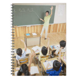 Elementary school students at school spiral note books