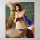 Elementary school students raising their hands print
