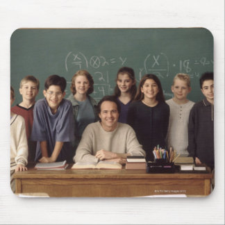 Elementary school students standing behind mouse pads