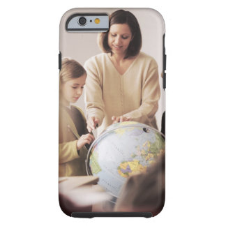 Elementary school teacher showing globe to tough iPhone 6 case