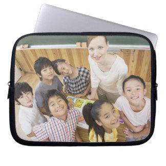 Elementary students and teacher laptop sleeve