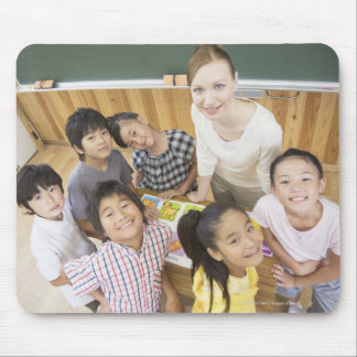 Elementary students and teacher mouse pads