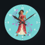 "Elena | Magic is Within You Round Clock<br><div class=""desc"">This enchanting design, spotlighting Avalor&#39;s most glamorous ruler shows the feisty princess playfully holding her enchanted scepter. The Disney princess looks radiant in red as she poses coyly against a glimmering backdrop. Magic is in the air and with a glint in her eyes and a radiant smile one thing is...</div>"