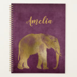 "Elephant Gold Violet Suede Planner<br><div class=""desc"">Coordinates well with Africa Animals product line products . Create your own coordinating products and office supplies by transferring the image using the transfer image beta link. Lightening fast! Super fast and super easy transfer tool! THE planner for all your planning needs! Art design composition and original art by JoSunshine,...</div>"