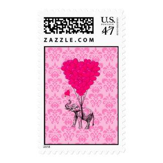 Elephant holding heart on pink damask postage