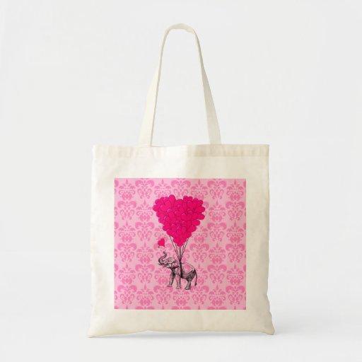 Elephant holding heart on pink damask tote bag