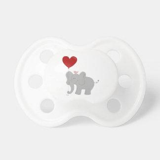 Elephant holding heart-shaped balloon pacifier